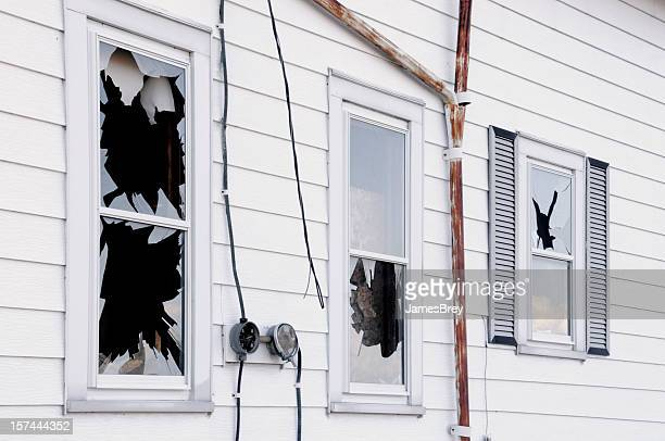 broken windows; vandalism, disaster, wind or earth quake damage - vandalism stock pictures, royalty-free photos & images