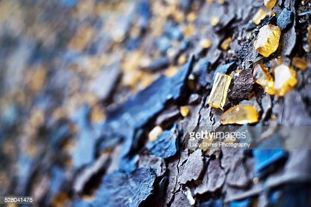 broken yellow glass and blue slate. - lucy shires stock pictures, royalty-free photos & images