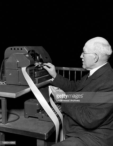 A broker checks the tape on one the new ticker tape machines now being used on the new Chicago Board of Trade Chicago Illinois June 13 1930