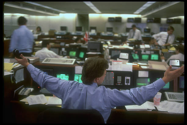 Broker Holding Arms Outspread On Floor O