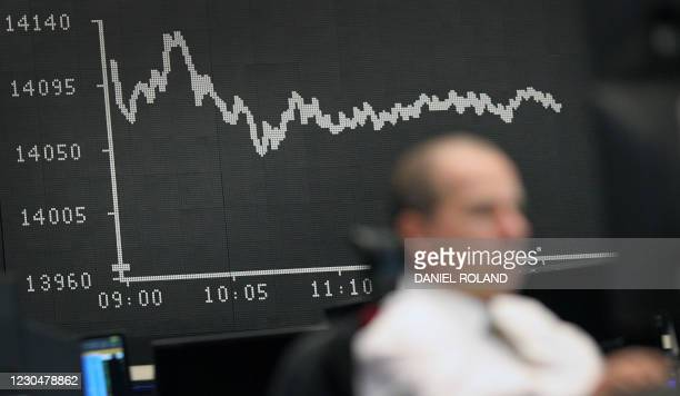 Broker is pictured at the stock exchange in Frankfurt, Germany, on January 8, 2021. - Germany's blue-chip DAX 30 index pushed on with its...