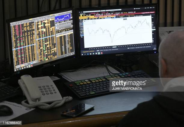 Broker looks at a screen at the Buenos Aires Stock Exchange in the financial district of Buenos Aires on August 20, 2019 after Argentina's President...