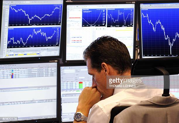 A broker looks at his screens at Frankfurt's stock exchange on September 15 as the German stock exchange went down 46 percent in the afternoon in the...