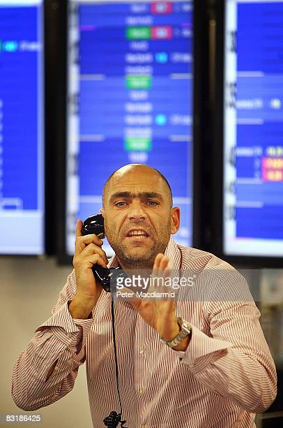 Broker on ICAP's dealing floor calls for prices on October 9, 2008 in London. Share prices are up on the day as markets react to the interest rate...