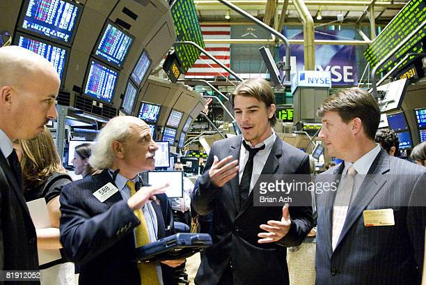 Broker Peter Tuchman shows actor Josh Hartnett and director Austin Chick how to make trades on the floor of the New York Stock Exchange on July 11...