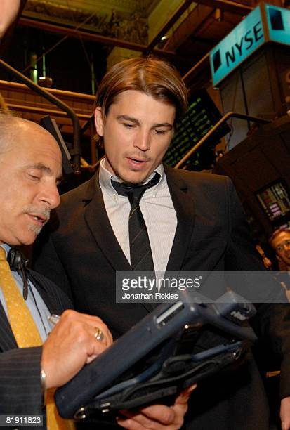 Broker Peter Tuchman shows actor Josh Hartnett how to make trades on the floor of the New York Stock Exchange July 11 2008 in New York City