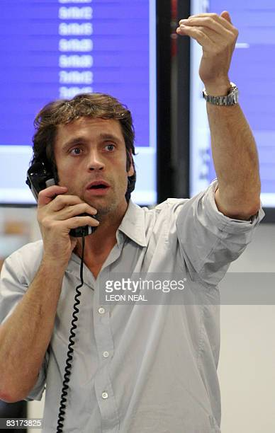 A broker reacts to news of a 05% cut in the interest rate from The Bank of England on ICAP's dealing floor in London on October 8 2008 The London...