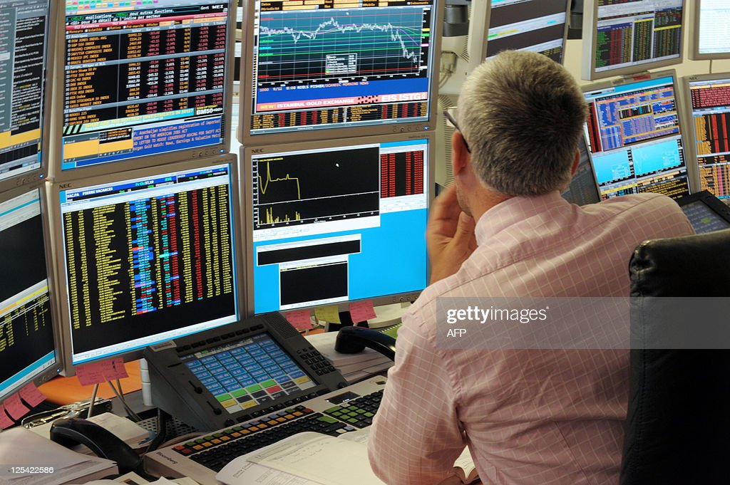 A broker watches screens in an office of the French investment company Aurel BGC in Paris on September 12, 2011. The French stock market plunged by 4.27 percent in early trading on Monday, and shares in BNP Paribas, Credit Agricole and Societe Generale banks were down by about 10.0 percent.