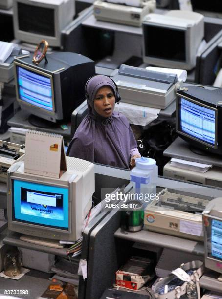 Broker works on the floor at the Jakarta Stock Exchange on November 18, 2008. Indonesia's annual economic growth slowed slightly in the third quarter...