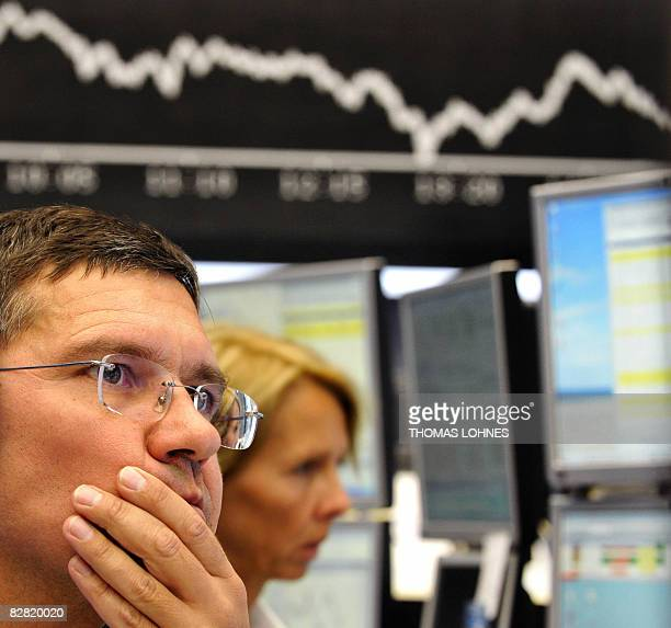 Brokers look at their screens at Frankfurt's stock exchange on September 15 as the German stock exchange went down 46 percent in the afternoon in the...