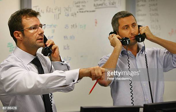 Brokers on ICAP's dealing floor call for prices on October 9, 2008 in London. Share prices are up on the day as markets react to the interest rate...