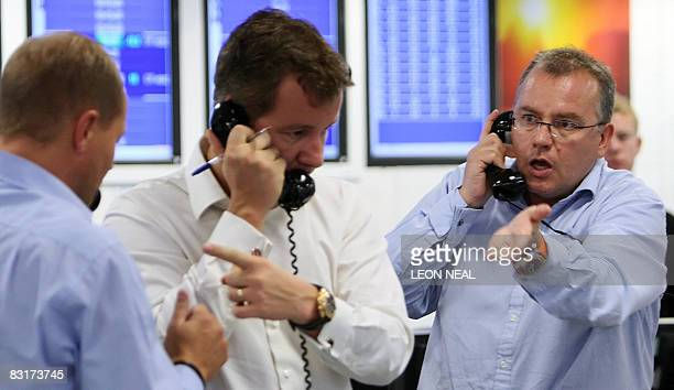Brokers react to news of a 05% cut in the interest rate from The Bank of England on ICAP's dealing floor in London on October 8 2008 The London stock...