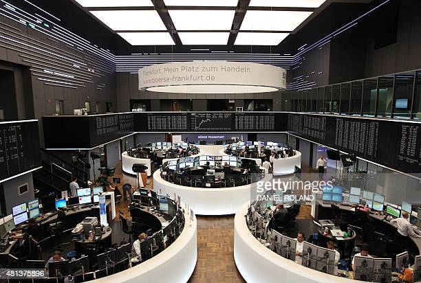 Brokers sit in front of their screens at the stock exchange in Frankfurt am Main western Germany on July 20 2015 as focus remained firmly on Greece...