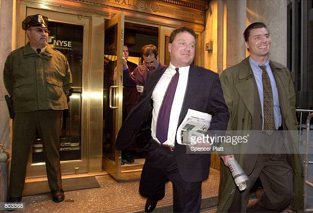 Brokers smiles as they leave the New York Stock Exchange April 18 2001 in New York City An unexpected interest rate cut and a stream of positive...
