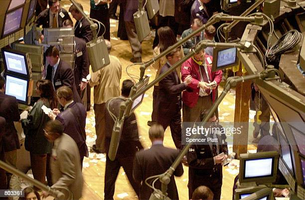 Brokers walk the floor at the New York Stock Exchange during the last minutes of trading April 18 2001 in New York City An unexpected interest rate...