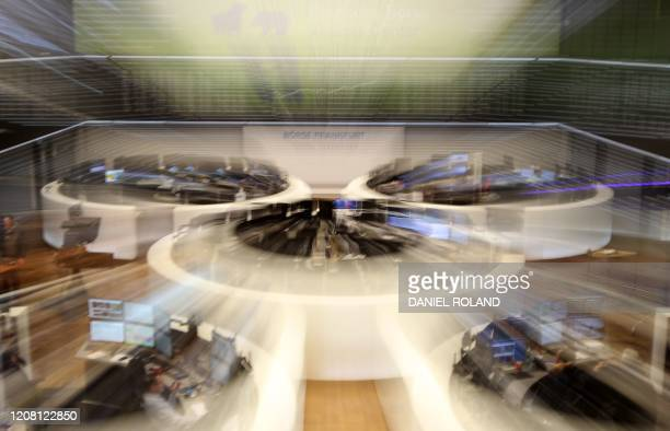 Brokers work at the stock exchange market in Frankfurt, Germany, on March 24, 2019. - The German Stock Exchange in Frankfurt rebounded strongly on...