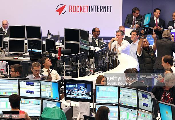 Brokers work during the IPO of German startup company Rocket Internet at the stock exchange in Frankfurt Germany on October 2 2014 AFP PHOTO / DANIEL...