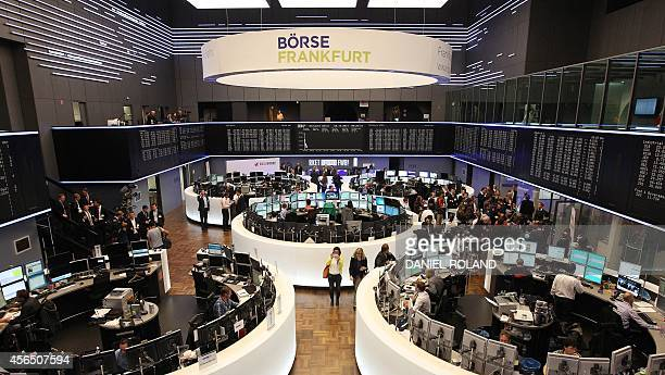 Brokers work during the IPO of German startup company Rocket Internet at the stock exchange in Frankfurt, Germany on October 2, 2014. AFP PHOTO /...
