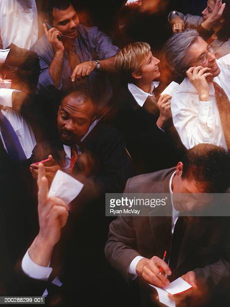 Brokers working during stock exchange session, elevated view