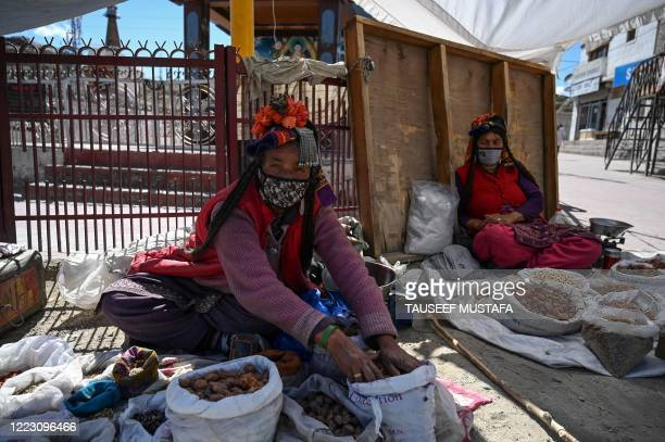 Brokpa tribal street vendors sell dry fruits on the roadside in Leh, the joint capital of the union territory of Ladakh, on June 27, 2020.
