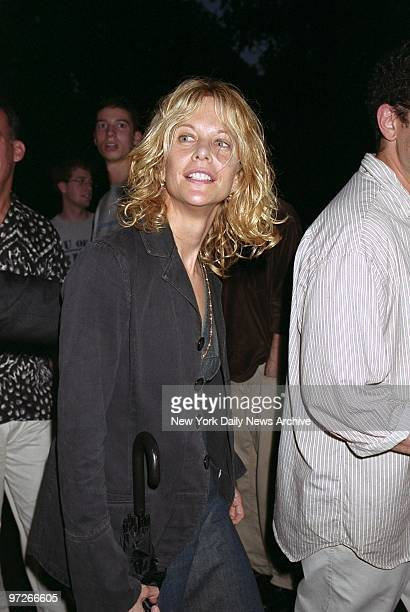 """Brolly in hand, Meg Ryan arrives for the opening night of Chekhov's """"The Seagull"""" at the Delacorte Theater in Central Park. Rain interrupted, then..."""