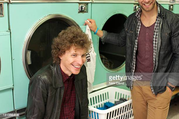 bromance - launderette stock pictures, royalty-free photos & images