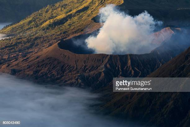 bromo volcano crater with sea of mist in a morning, east java, indonesia - land geografisches gebiet stock-fotos und bilder