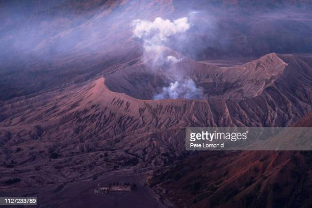 bromo volcano erupting - caldera stock pictures, royalty-free photos & images