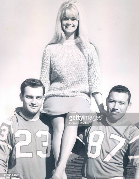 Bronco Beauty Goldenhaired Susan Kay Hawkins 21 today gets team support from Denver Broncos Goose Gonsoulin left and Lionel Taylor in her quest for...