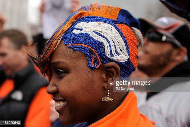 Bronco fan Danielle Lewis did her own hair Friday January 13 for the Denver Broncos Spirit Rally on Bannock Street in front of the Denver City and...