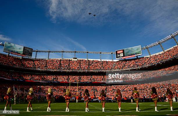 Broncos cheerleaders watch as jets fly over the stadium during the national anthem The Broncos played the Kansas City Chiefs at Sports Authority...
