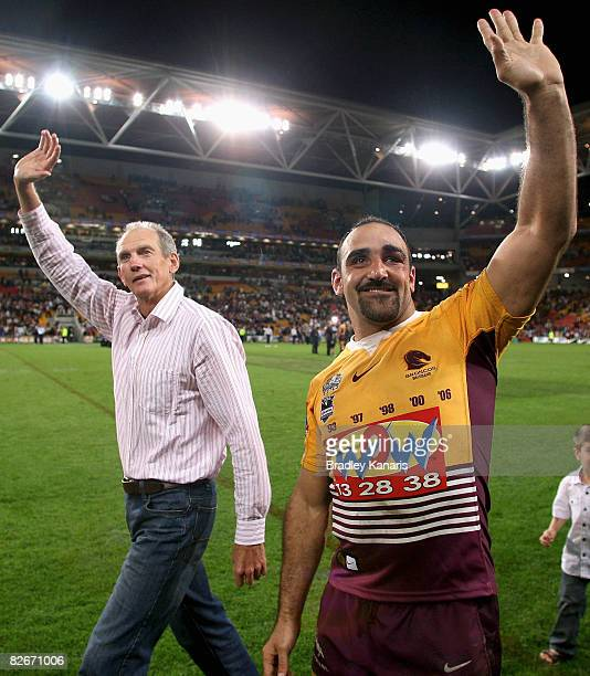 Broncos Coach Wayne Bennett and Tonie Carroll of the Broncos farewell fans after the round 26 NRL match between the Brisbane Broncos and the...