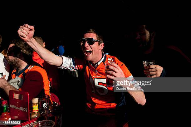 Broncos fan cheers as action gets underway in the first half of Super Bowl XLVII between the Denver Broncos and the Seattle Seahawks at a bar called...