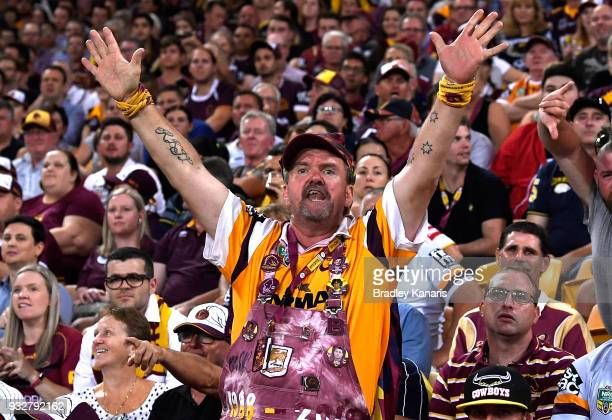 Broncos fan shows his support during the round two NRL match between the Brisbane Broncos and the North Queensland Cowboys at Suncorp Stadium on...
