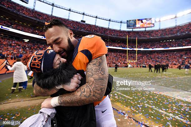 Broncos guard Louis Vasquez celebrates with his fiancee Royce Flores after Denver's 2018 win in the AFC Championship game against the New England...