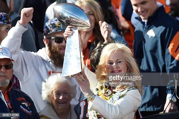 Broncos owner Pat BOwlen's wife Annabel Bowlen hoists the Lombardi Trophy during the Denver Broncos Super Bowl championship celebration and parade on...