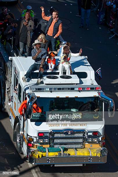 Broncos owner Pat Bowlen's wife Annabel Bowlen rides a Denver Fire Department fire truck with Von Miller Peyton Manning DeMarcus Ware and the...