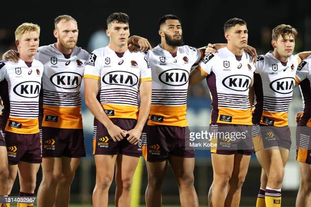 Broncos players pause during an ANZAC ceremony before the round seven NRL match between the Parramatta Eels and the Brisbane Broncos at TIO Stadium,...