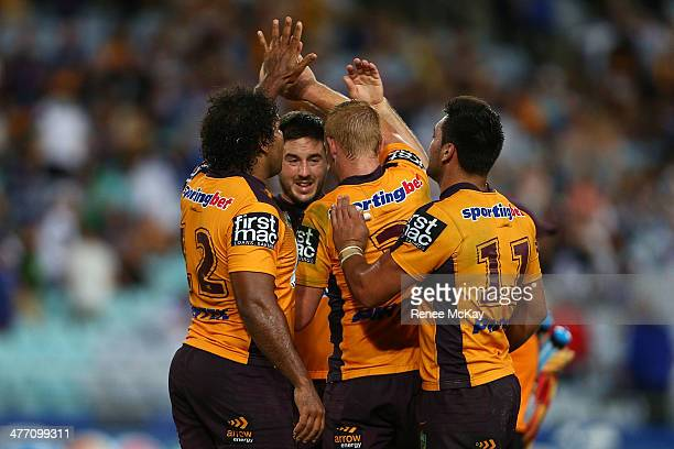 Broncos players Sam Thaiday Anthony McCullough Jack Reed and Alex Glenn celebrate at the final whistle after the round one NRL match between the...