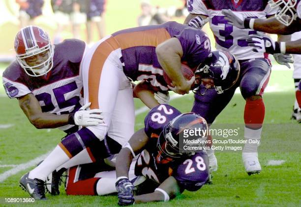 Bronco's punter Tom Rouen is sacked by Bill's Tony Driver and falls over team mate Kenoy Kennedy inside the 20 yard line setting up a Buffalo...