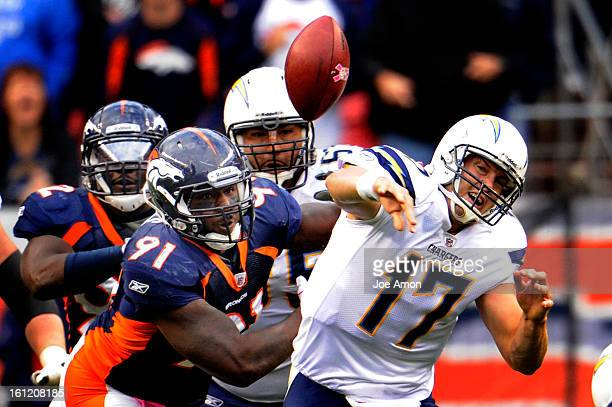 Broncos Robert Ayers gets to Chargers quarterback Philip Rivers. Rivers fumbled the ball. Sunday October 9, 2011at Sports Authority Field at Mile...