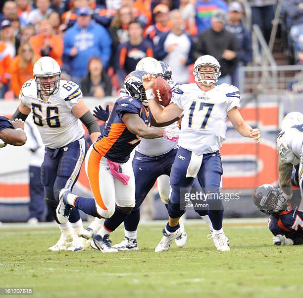 Broncos Robert Ayers pushes Chargers quarterback Philip Rivers. Rivers fumbled the ball. Sunday October 9, 2011at Sports Authority Field at Mile...