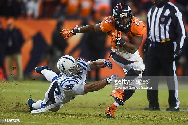 Broncos running back CJ Anderson breaks through a tackle by Colts safety LaRon Landry to convert a fourth down on Sunday Jan 11 at Sports Authority...