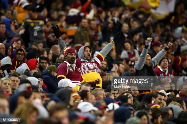 Broncos supporters celebrate a try during the NRL Qualifying Final match between the Sydney Roosters and the Brisbane Broncos at Allianz Stadium on...