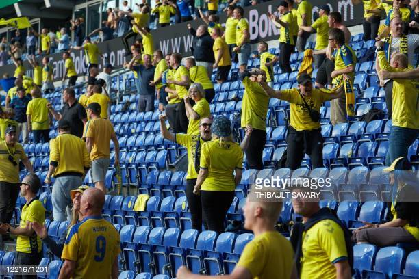 Brondby fans observing social distancing celebrate their team scoring against FC Copenhagen at Brondby stadium, Denmark on June 21, 2020. - The first...