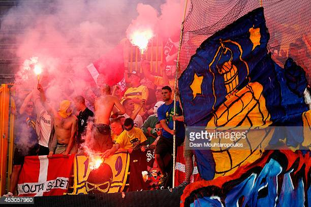 Brondby fans show their support by cheering singing and waving flares during the UEFA Europa League 3rd qualifying round first leg match between Club...