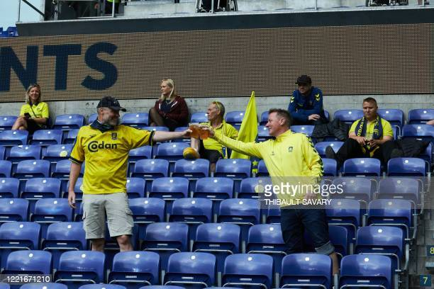 Brondby football fans partly observic social distancing attend a match against FC Copenhagen at Brondby stadium, Denmark on June 21, 2020. - The...
