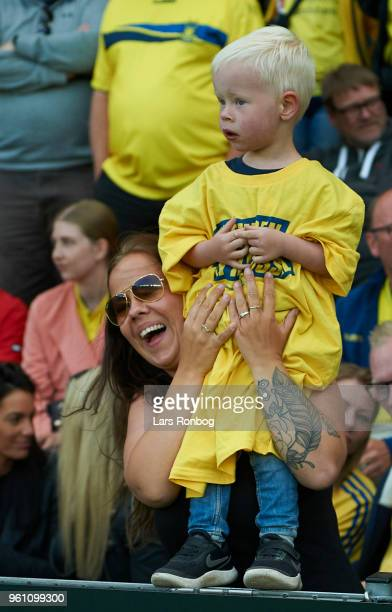 Brondby IF fan mother with her son prior to the Danish Alka Superliga match between Brondby IF and AaB Aalborg at Brondby Stadion on May 21 2018 in...