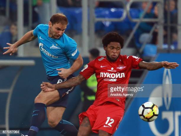 Bronislav Ivanovic of FC Zenit SaintPetersburg in action against Luis Adriano of FC Spartak Moscow during the Russian Premiere League match between...