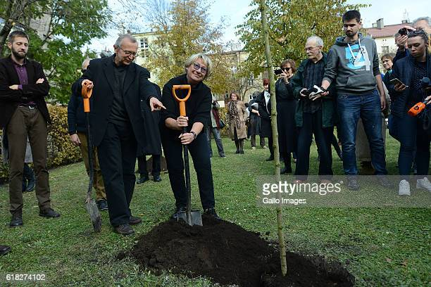 Bronislaw Maj Ewa Lipska and other guests attend the ceremony of planting Wislawa Szymborskaâs acacia on October 24 2016 near Dworek Lowczego in...
